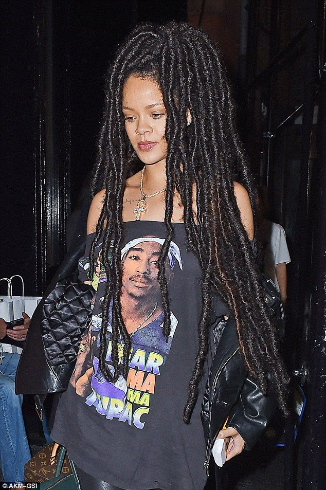 Paying tribute: The 28-year-old singer donned a vintage off-the-shoulder Tupac Shakur tee...