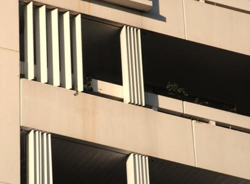 Vertical pivoting louvers protecting balcony [205] | filt3rs