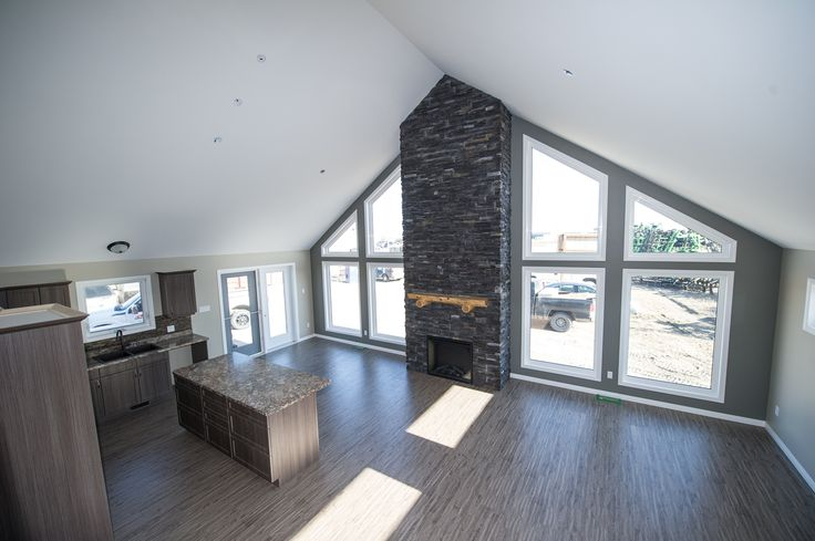 Open design concept in the Greenville RTM with custom fireplace.  http://bailey-homes.ca/photo-galleries/2015-the-greenville-rtm-photo-gallery/