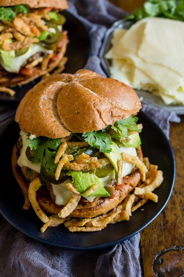 This Baja burger is studded with jalapeno, lime, spices and topped with cheese, salsa, pickled jalapenos, crispy fried onions, avocado and cilantro.