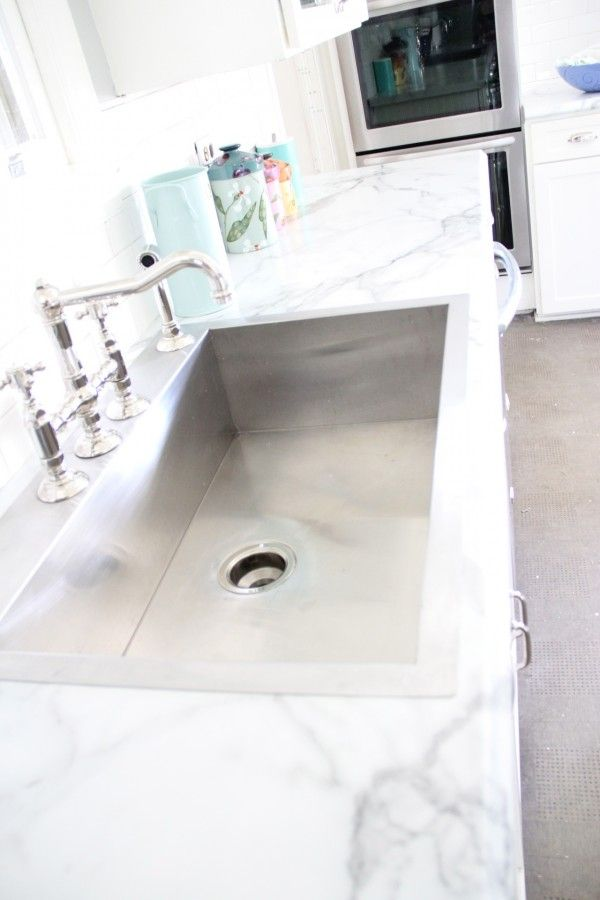 """Choosing Formica """"marble"""" over the real thing. In this kitchen the difference was over 4000 dollars."""