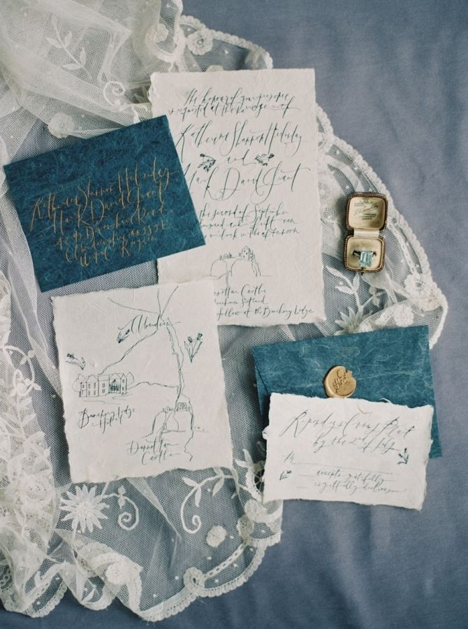 Elegant blue and gold calligraphy invitation suite: http://www.stylemepretty.com/2015/11/12/elegant-cliff-top-ceremony-in-scotland/ | Photography: Laura Gordon Photography - http://lauragordonphotography.com/