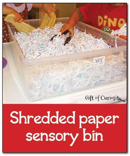 Shredded paper sensory bin - simple, inexpensive, and fun sensory play || Gift of Curiosity