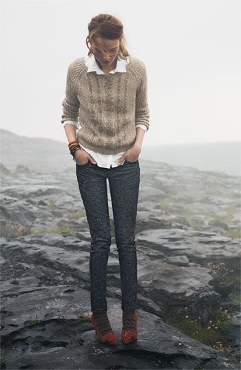 Tan sweater over white collared shirt with skinny jeans and socks/tights with heels.