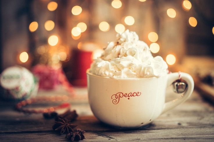 Hot cocoa in christmas mug with whipped cream on rustic wooden b - Hot cocoa in christmas mug with whipped cream on rustic wooden background