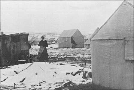 Women and children were forced to live in flimsy tents with snow on the ground.