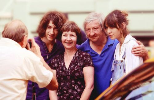 Alex Turner with his parents, Penny and David Turner, and Alexa Chung.