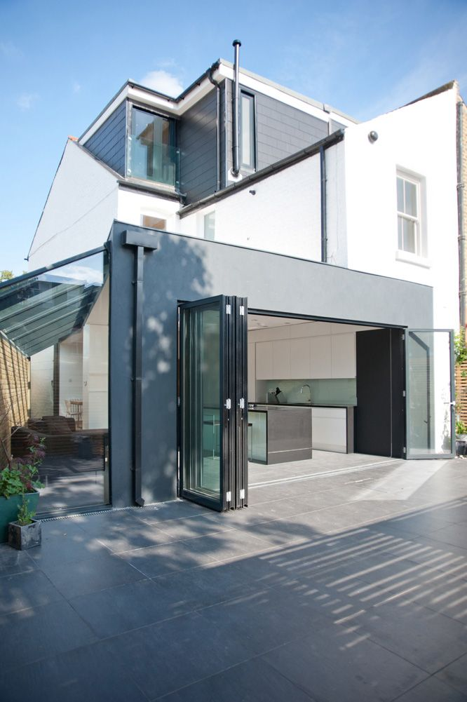 Bright open relaxed victorian end of terrace extension for Garage extension designs
