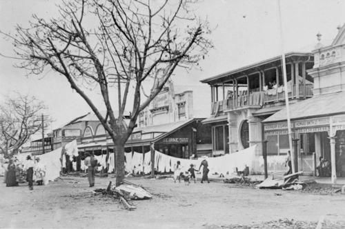#ThrowBackThursday This year marks 100 years since the 1918 cyclone that hit Mackay. An image of Sydney Street, with Beirne Mackay Limited hanging its manchester supplies out to dry, and the Commercial Banking Company of Sydney doing likewise with carpets after the great cyclone of January 20-21, 1918 which devastated Mackay.
