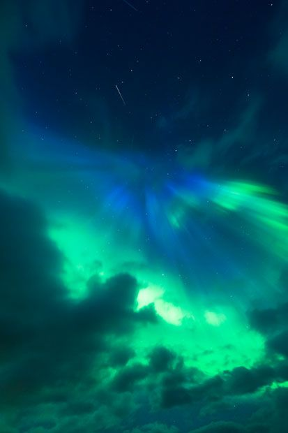 A green and blue aurora is seen in the night sky over Flostrand in Nordland, Norway / photo by Tommy Eliassen