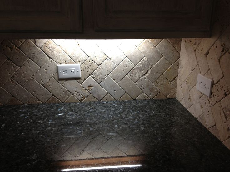 Tumbled travertine herringbone backsplash never grout for Best grout color for travertine tile