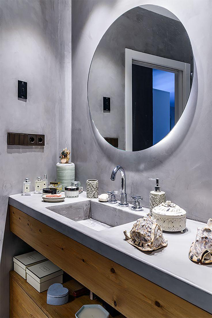 Enciemra de lavabo en microcemento. Mecanismos Jung LS 990. Reforma en  Madrid Q Arquitectura