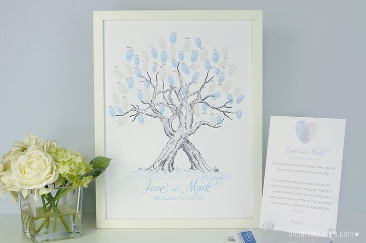 Winter wedding snow fingerprint tree - an alternative to a traditional guest book.  https://thelittletouches.com/collections/wedding-fingerprint-trees/products/snow-themed-guest-fingerprint-tree