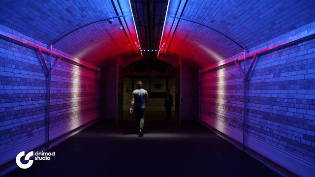 """Walk the Light"" it becomes the visitor who determines that change in the lighting.   Their movement through the Victoria & Albert Museum's Exhibition Road tunnel entrance directly controls this innovative lighting installation.  This experimental interactive lighting design project creates a band of white light that physically follows the visitor, forming a bright line of light tracking"
