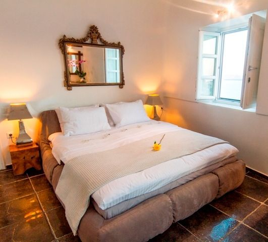 Exclusive Suite at Aspaki is decorated with warm, earthy colors and antique style details.