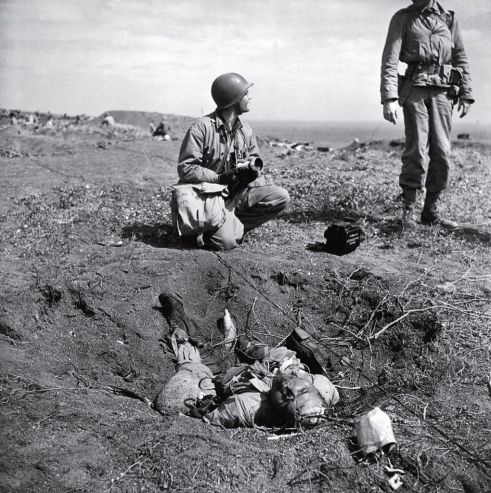 W. Eugene Smith—Time & Life Pictures/Getty ImagesUnpublished.American troops chat near a dead Japanese soldier on Iwo Jima. The degree to which the Japanese were willing to fight to the death, rather than surrender, is summed up in one remarkable statistic: Close to 20,000 Japanese soldiers were killed during the battle; only around 200 were captured.