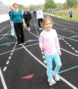 Anabel Cunningham had a special friend with her at the Clinton School District Wellness Walk at the Clinton High School track on Saturday. / Clinton Herald