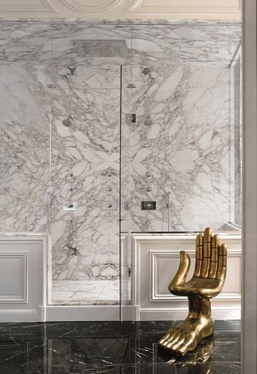 An unexpected seat in a gorgeous marble bath! Pedro Friedeberg iconic chair. {carrera marble love}