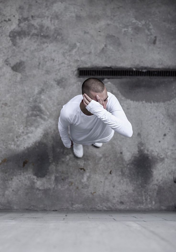 Male model in white. Fashion photography