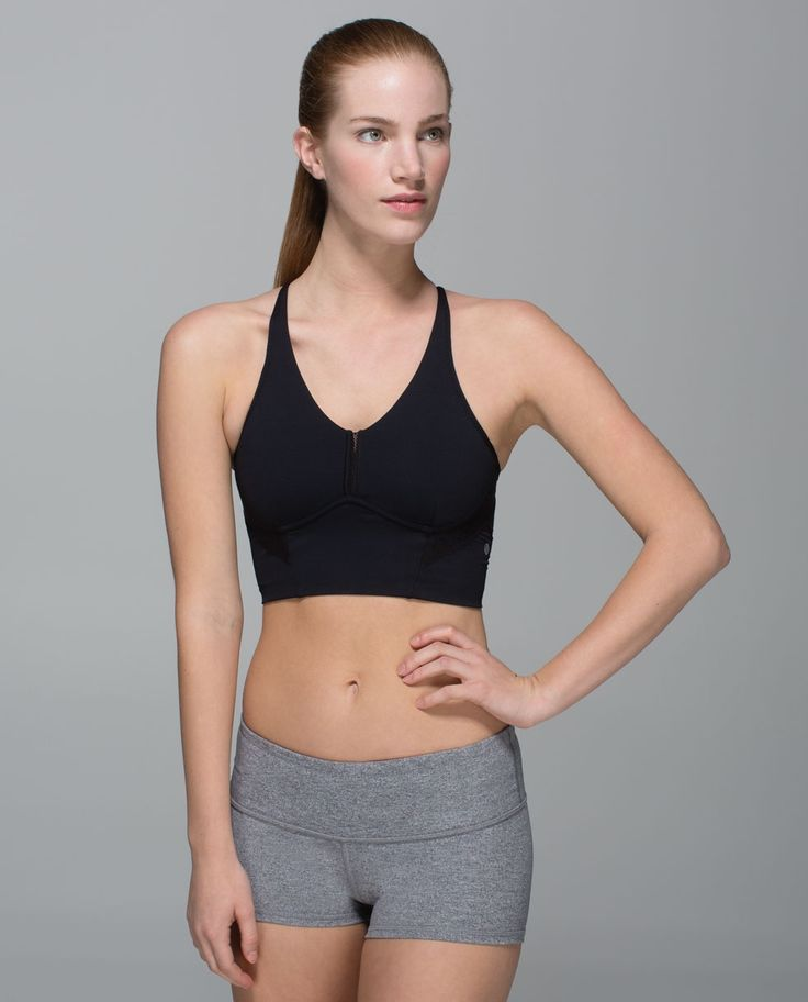 We wear this sweat-wicking, strappy bra on days we feel like wearing not much else. This long line bra gives us options when we're   bringing the heat—we layer it under a tank to warm up and wear it on   its own when our temperature rises.