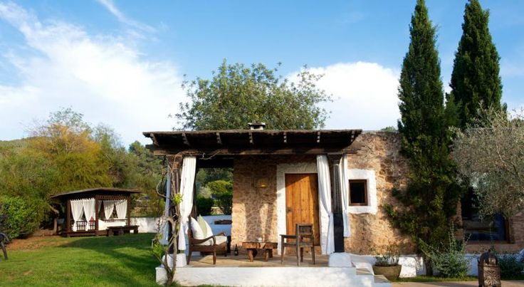 Agroturismo Atzaró Santa Eularia des Riu Set on an orange grove in the Ibizan countryside, this beautiful rural hotel features a small outdoor swimming pool and small spa. It offers free buffet breakfast.  Agroturismo Atzaró's rooms are individually styled.