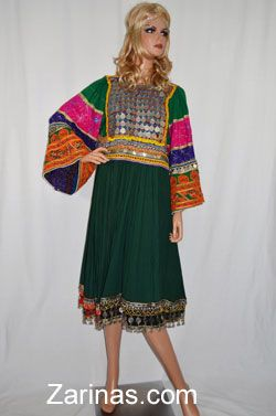 Suriya Kuchi Afghan Dress.  One of a kind, coined Kuchi Afghan dress with vibrant colors and embroidered sleeves. Hemline is trimmed with elegant coins, beads, and bells going all the way around the skirt. Perfect for special occasions. Please note: head crown is sold separately. Does not come with chador (head scarf) or pants.