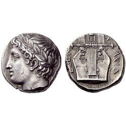 Greek coins, Olynthus, Tetradrachm. Greek coins, Olynthus, Tetradrachm ca. 370, AR 14.41 g. Laureate head of Apollo l. Rev. [C] - A - LKID - EWN Seven-stringed lyre. SNG ANS 484 (these dies). Robinson-Clement 75. Rare.