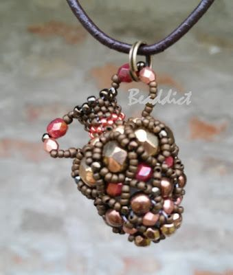 Amphora pendant. Pattern by Delica-Tess. Beaded by Beaddict. Seed beads, fire polished beads, 3D.