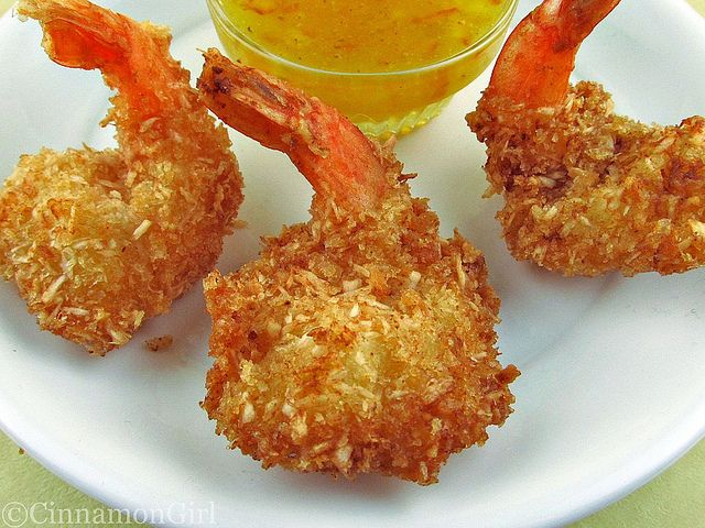 Coconut Shrimp w/Orange Dipping Sauce  Ingredients  1 cup flour  2 eggs  1 cup panko crumbs  1 cup sweetened or unsweetened organic coconut flakes (I use sweet)  1 pound medium-large shrimp, cleaned, deveined and butterflied (optional)  vegetable oil for frying  1/2 cup orange marmalade  2 tablespoons rice or white wine vinegar  1 teaspoon dijon mustard  a dash or more of red pepper flakes