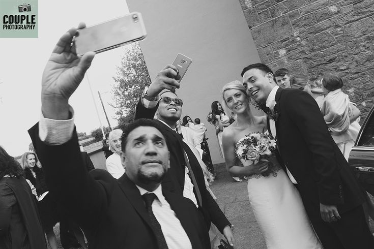 Friends and family of the newlyweds Que up for selfies! Weddings at Durrow Castle photographed by Couple Photography.