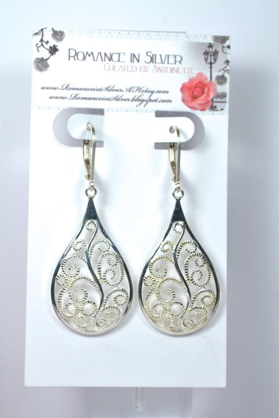 These stunning filigree earrings measure 2 inches in length.  925 sterling silver comfortable leverback earring hooks.  Style-filigree, trendy, high fashion, timeless  All purchases come gift wrapped and ready for gift giving. These are very versatile and look good with every outfit.  There is another listing for a necklace that matches these earrings if you would like to have a matching set. Sold separately.    http://romanceinsilver.etsy.com
