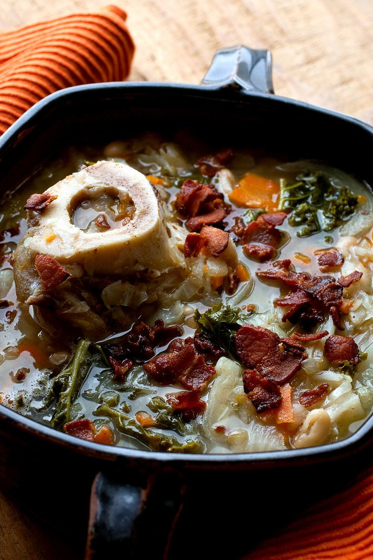 NYT Cooking: This hearty soup requires a good afternoon simmer, filling your house with the aromas of all things good and warming. The marrow imbues the broth with a silkiness and richness, and the kale is thrown in for color and health. You might want hot sauce, or not. Either way, a bowl of this is the kind of thing that cures what ails you.