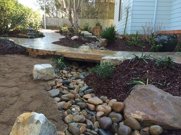 Japanese Garden Using Oriental Design Principles, North Shore Sydney – Sandstone Boulders and Brick Paving and Pathways, Bridge, Water Feature, Water Bowl. Japanese Landscape Design Sydney. Oriental Landscapers North Shore.