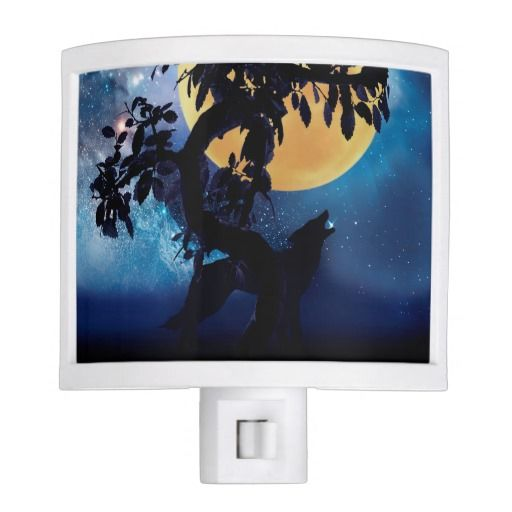 Wolf howling at the moon night light