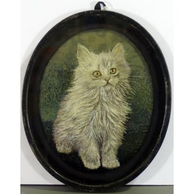Embroidered cat in oval frame made by Zola Janson of Lilydale, Victoria in the 1930s.