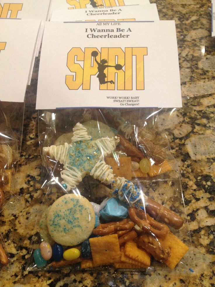 Cheerleading snack Edible Spirit Stick made of a pretzel stick affixed to a decorated shortbread star Add team colored sweet and salty mix of candy, pretzels and cheezits
