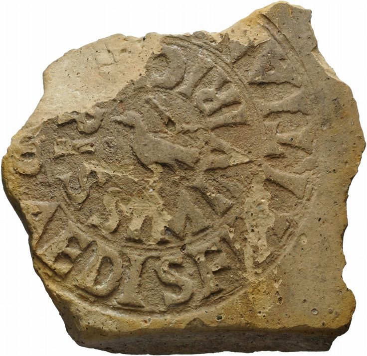 Roman seal on roman brick stamp, 1st half of 2nd century A.D. 3 cm high and 11 cm long. Roman seal on roman brick stamp, roman terracotta roof tile inscribed  [Ex Pr]aedis Fl(avi) Titia[ni] / viri c[lar]issimi, in the circle a bird keep two cherries with beak. Similar item has been found in February 1890 in Rome near Palazzo Menotti, during contruction works of river Tevere wall (G. Gatti, Atti della Reale Accademia dei Lincei - VII, 1890, p. 32). Private collection