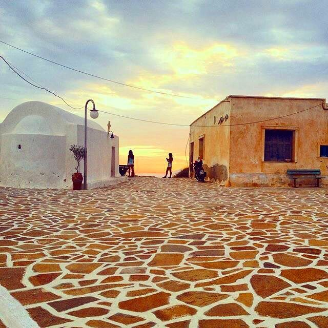 Absolutely lovely sunset time at the central square of Anafi island ( Ανάφη ) ❤️. Very small and pure island , without organized tourism at all ... A unique kind of beauty !