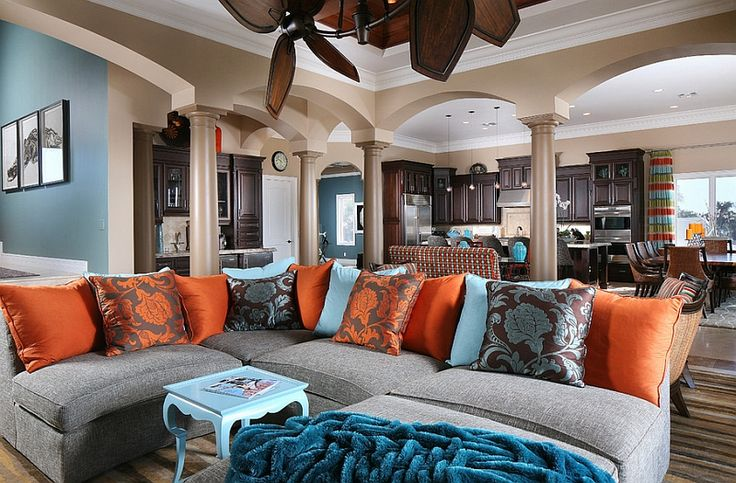 Grey sofa. Orange and blue accents.  Hot Summer Color Combinations Bring Home Cheerful Exuberance!