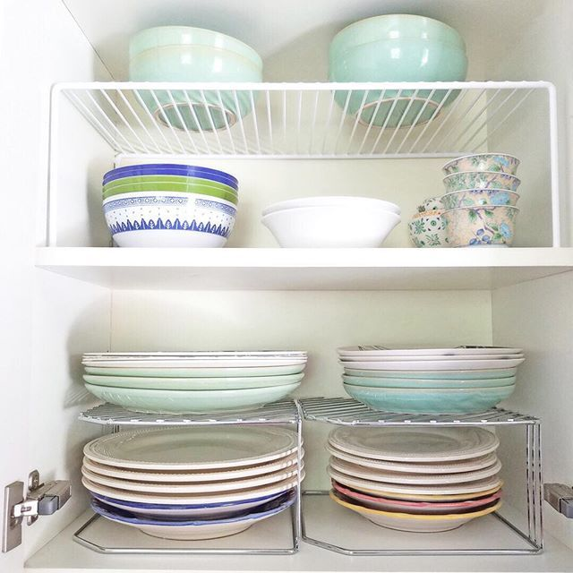Shelf Risers If You Can T Create More Storage Space In Your Home Maximize The Space You Have With Shelf Risers In Your Kitchen Cab Storage Spaces Shelves Home