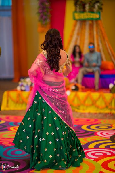 Light Lehengas - Green Lehenga with Golden Embroidry, a Gold Choli and a Net Pink Dupatta | WedMeGood #wedmegood #indianbride #indianwedding #lehenga #choli #mehendioutfit #bridal