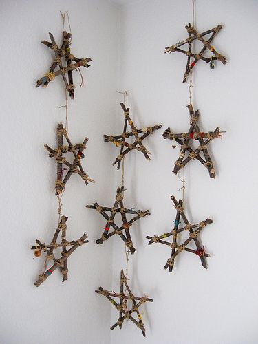 Star mobile made from sticks - use clothespins to hold sticks in place while tying string around to attach them. Just love the nature and simplicity of this decoration.