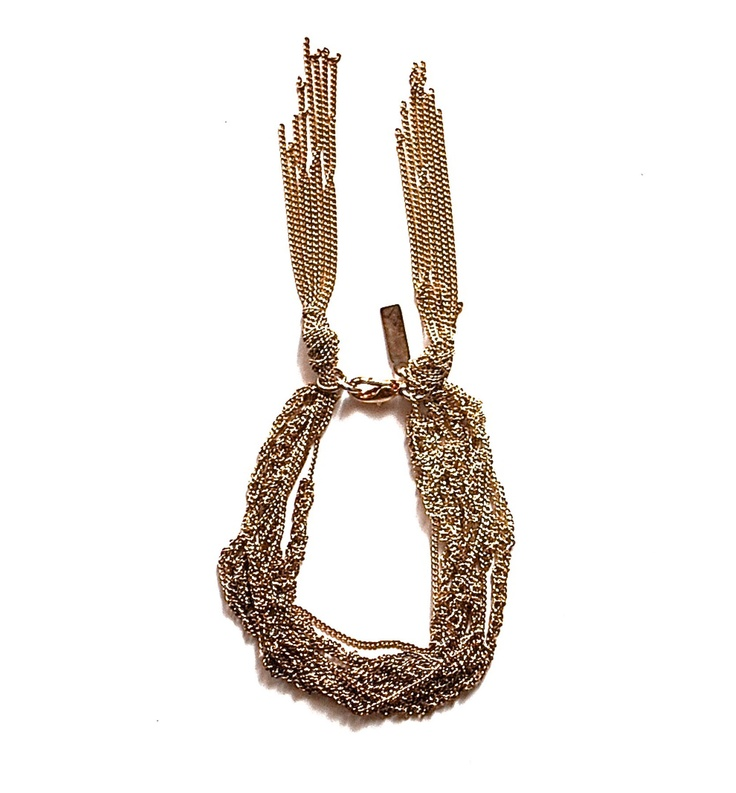 This bracelet by Maripossa is made from fine silver and copper oxidised chains, featuring chain tassles at the clasp.