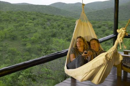 Hammock on chalet deck at Leopard Mountain Game Lodge