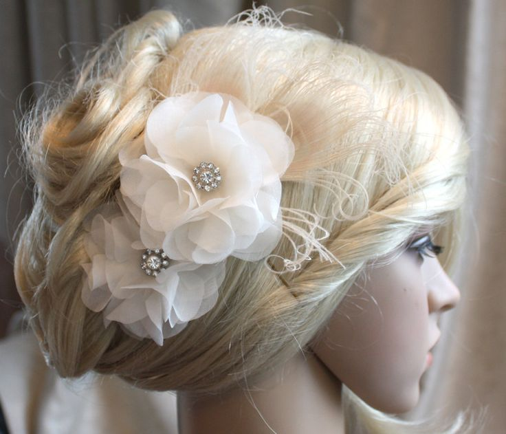 Ivory Silk organza flowers hair clip and birdcage veil ( 2 items) wedding reception bridal party. $120.00, via Etsy.