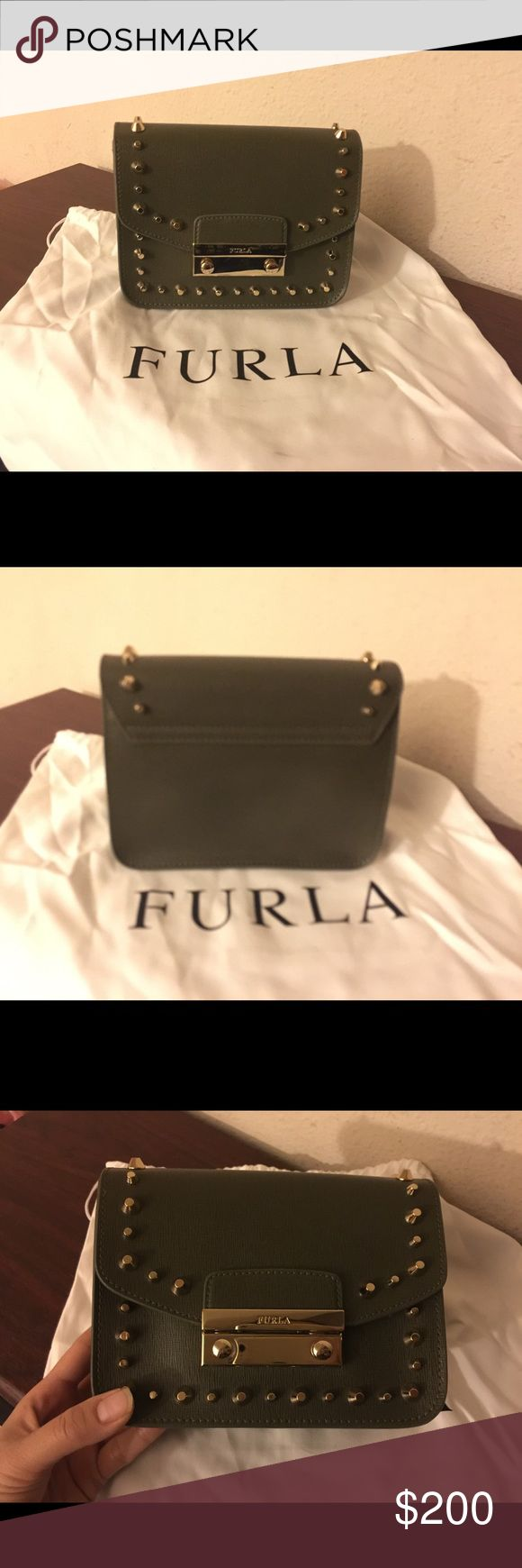 Furla Julia mini stud cross body bag Brand new. I bought it from gilt.com Just too small for my liking. It will fit regular iPhone. Comes with dust bag. The dust bag have stain and I receive it like that. It was dirty when I got it.  Super cute though. You can remove the strap and use it as a clutch. It in salvia color. It like dark green. Furla Bags Crossbody Bags