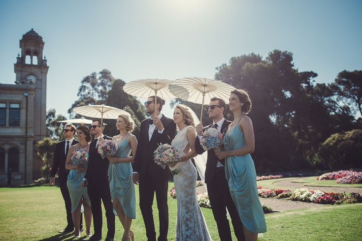 Sunshine photos parasol umbrella hot summer wedding Melbourne Australia photographer Werribee Garden