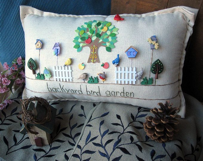 This flower-themed hand-made muslin needlework pillow is perfect for spring and summer decor and fans of flowers and gardening! Size is approximately 15 x 8.