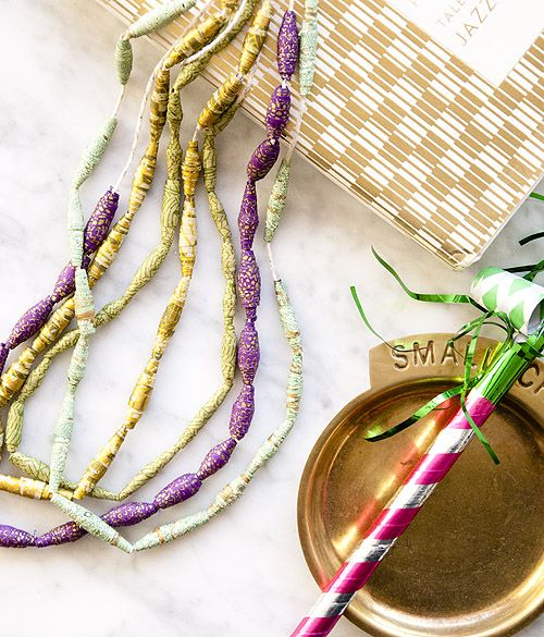 Ooh, love this Mardi Gras-themed paper craft. You could even used old book pages for this - find some illustrations in purple and gold and go to it!
