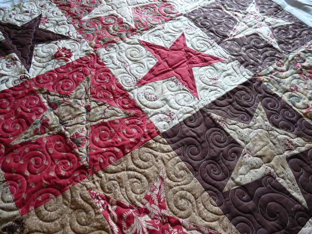 Buggy Barn star crossing... love the design, the quilting is pretty amazing as well !!